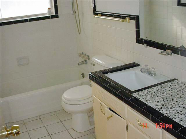This bathroom has an interesting black and white small diamond pattern - Retro Black Amp White Bathrooms Lost In Austin
